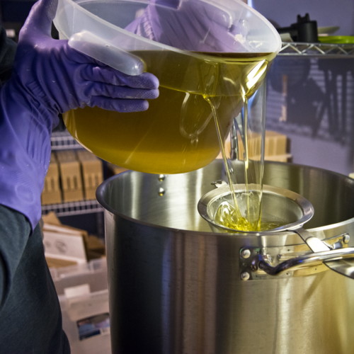 Pouring oils for goat milk soap making